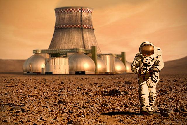 הדמיה של מתיישב מאדימי על רקע תחנת כוח ויישוב ראשוני. קרדיט: D Mitriy