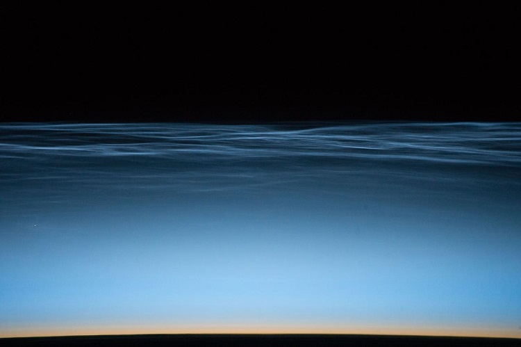 Noctilucent clouds | צילום: NASA/Jeff Williams