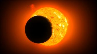 כוכב לכת, וברקע הכוכב אותו הוא מקיף